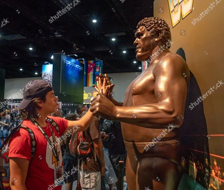 Luis Cosme, Andre the Giant. Luis Cosme, of Tijuana, Mexico, measures his hand against a statue of Andre the Giant on day two of Comic-Con International on in San Diego, CA