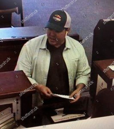 This surveillance photo released by the Santa Barbara County Sheriff's Office shows the suspect in a bank robbery in Goleta, Calif. Police said Keith David Goodwin, 41, was found dead from a self-inflicted gunshot wound after the robbery