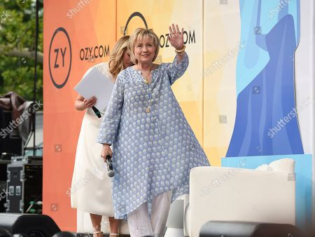 Democratic presidential candidate and former Secretary of State Hillary Rodham Clinton waves to the crowd before a conversation with Laurene Powell Jobs at OZY Fest in Central Park, in New York