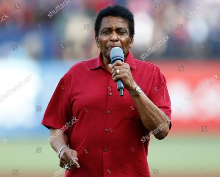 Country music star Charley Pride sings the National Anthem before a baseball game between the Cleveland Indians and the Texas Rangers, in Arlington, Texas