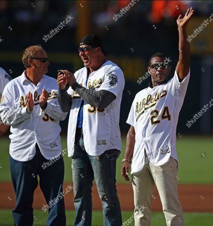 Terry Steinbach, Rickey Henderson, Jose Canseco, Sean Manaea. Former Oakland Athletics' Rickey Henderson, right, waves to fans beside Jose Canseco, center, and Terry Steinbach during a reunion of the 1989 world series team prior to a baseball game against the San Francisco Giants, in Oakland, Calif