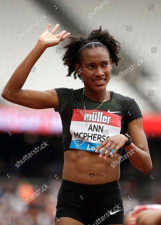 Stephenie Ann McPherson of Jamaica celebrate after winning the women's 400 meters race at the IAAF Diamond League athletics meeting at London Stadium in London