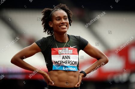 Stephenie Ann McPherson of Jamaica smiles after winning the women's 400 meters race at the IAAF Diamond League athletics meeting at London Stadium in London
