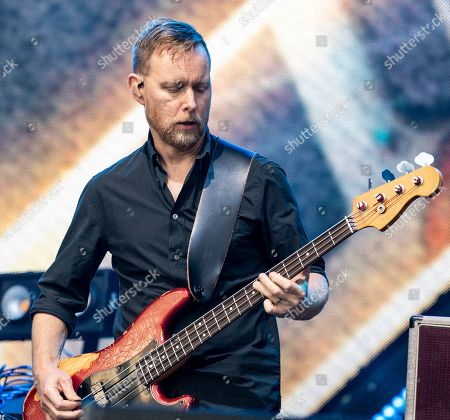 The American rock band Foo Fighters with bass guitar player Nate Mendel performs at Fenway Park, in Boston
