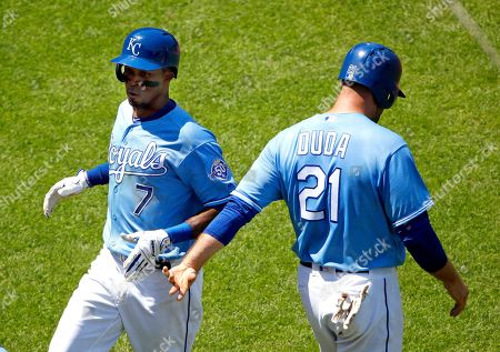 Stock Image of Kansas City Royals' Rosell Herrera (7) and Lucas Duda celebrate after scoring on a two-run double by Alex Gordon during the fifth inning of a baseball game against the Minnesota Twins, in Kansas City, Mo