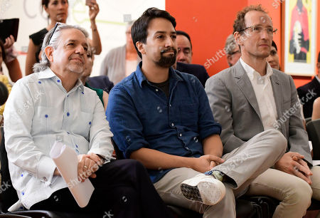 Lin-Manuel Miranda, center, sits with his father Luis Miranda, left, and Jeffrey Seller, producer of the musical Hamilton, during a press conference at the Art Museum of Puerto Rico in San Juan, Puerto Rico, . Lin-Manuel Miranda announced he has helped create a multimillion-dollar fund to boost the arts in the U.S. territory as it struggles to recover from Hurricane Maria
