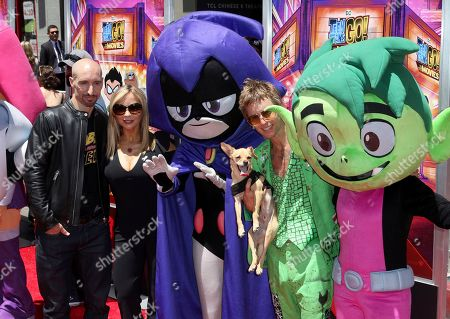 "Scott Menville, Tara Strong, Greg Cipes. Scott Menville, from left, Tara Strong and Greg Cipes pose with some of the movie characters at the LA Premiere of ""Teen Titans Go! To the Movies"" at the TCL Chinese Theatre, in Los Angeles"