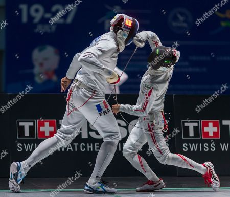 Yannic Borel (L) of France competes against Koki Kano (R) of Japan during the men's epee qualification round match at the Fencing World Championships in Wuxi, China, 23 July 2018.