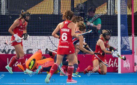 Sophie Bray clears a shot by Amanda Magadan