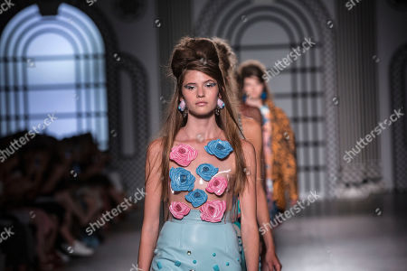 Stock Image of Model on the catwalk wearing Holly Fulton design.