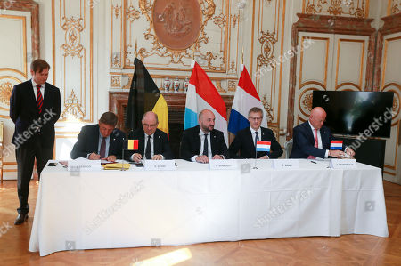 (L-R) Belgium's Vice-Prime Minister and Interior Minister Jan Jambon, Belgian Justice Minister Koen Geens, Etienne Schneider, the Interior Minister of Luxemburg, Luxembourg's Minister of Justice Felix Braz and Dutch Minister of Justice and Security Ferdinand Grapperhaus sit alongside each other during the signing of the revised and extended 'Benelux Treaty On Police Cooperation' at Egmont Palace in Brussels, Belgium, 23 July 2018. The revised treaty shall improve the exchange of data and cross-border investigations between Belgium, the Netherlands and Luxembourg.