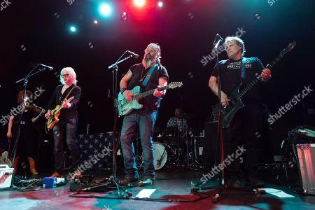Stock Image of Steve Earle & The Dukes - Chris Masterson, Steve Earle, Kelley Looney
