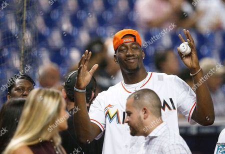 Edrice Adebayo, prepares to throw out the first pitch of the Miami Marlins and Atlanta Braves baseball game, in Miami