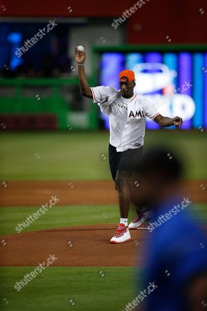 Stock Photo of Edrice Adebayo, throws out the first pitch of the Miami Marlins and Atlanta Braves baseball game, in Miami