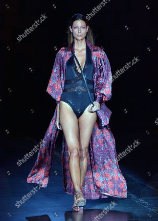 Stock Photo of A model exhibits a creation from the Spanish designer Custo Dalmau during the 29th edition of Colombiamoda in Medellin, Colombia, 23 July 2018. Colombiamoda runs from 24 July to 26 July 2018.
