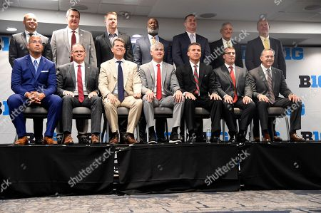 Big Ten Conference head football coaches sit for a portrait during the Big Ten Conference NCAA college football media days in Chicago, . Front row, from left, Penn State's James Franklins, Indiana's Tom Allen, Michigan's Jim Harbaugh, Maryland's DJ Durkin, Ohio State's Urban Meyer, Rutger's Chris Ash and Michigan State's Mark Dantonio. Back row, from left, Minnesota's P.J. Fleck, Wisconsin's Paul Chryst, Nebraska's Scott Frost, Illinois' Lovie Smith, Northwestern's Pat Fitzgerald, Iowa's Kirk Ferentz and Purdue's Jeff Brohm
