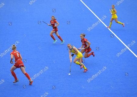 Emily Smith of Australia runs through several Belgium players