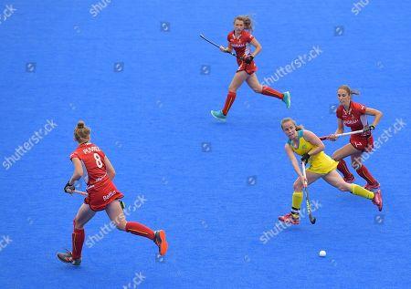 Stock Picture of Emily Smith of Australia runs through several Belgium players
