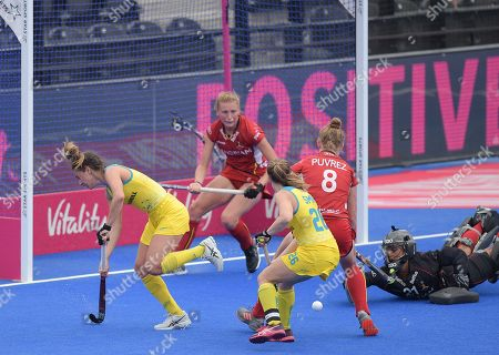 Brooke Peris of Australia and Emily Smith fail to score with Aisling D'Hooghe of Belgium out of position