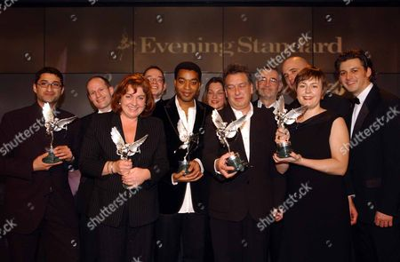 Evening Standard Film Awards 2003 At The Savoy Hotel London... Stars Of Film And Stage Attended The Glamourous Event. Winners On Stage. L-r: Most Promising Newcomer Asif Kapadia For Directing 'the Warrior'. Best Screenplay Neil Hunter For 'lawless Heart'. Best Technical Achievement Eve Stewart For Production Design Of 'all Or Nothing'. Best Screenplay Tom Hunsinger For 'lawless Heart'. Best Actor Chiwetel Ejiofor From 'dirty Pretty Things'. The Special Award Barbara Broccoli For 40 Years Of James Bond 007 Films. Best Film Award Stephen Frears Director Of 'dirty Pretty Things'. The Special Award Michael G Wilson For 40 Years Of James Bond 007 Films. Peter Sellers Award For Comedy Keith Fulton Lucy Darwin & Louis Pepe 'lost In La Mancha'. Producer Lucy Darwin And Her Directors Keith Fulton And Louis Pepe...