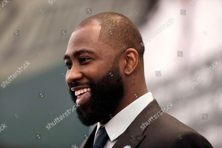 Former New York Jets cornerback Darrelle Revis speaks during a news conference officially announcing his retirement from NFL football, in Florham Park, N.J. Revis leaves behind an 11-season career that included four All-Pro selections and a Super Bowl win with the New England Patriots