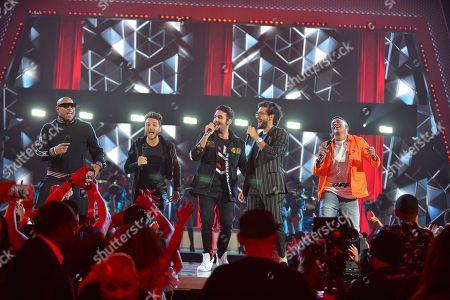 Alexander Delgado and Randy Malcom of Gente de Zona and IL VOLO performs on stage at Univision's Premios Juventud 2018 at Watsco Center