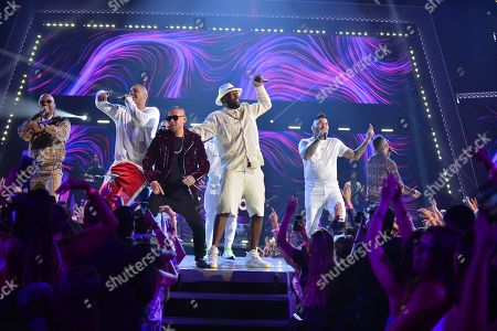 Taiger, Yomil y el Dany, Jacob Forever, DJ Chino, Lenier, El Micha and Chacal performs on stage at Univision's Premios Juventud 2018 at Watsco Center