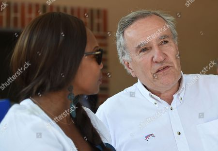 French sports minister Laura Flessel talks with president of the federation, Serge Lecomte (R) at the Federal Equestrian Park of Lamotte Beuvron