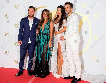 Stock Image of Cesc Fabregas, Daniella Semaan, Lionel Messi and Antonela Roccuzzo