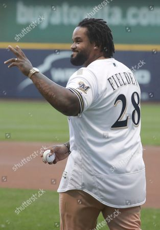 Former Milwaukee Brewers' Prince Fielder is honored at a ceremony before a baseball game against the Washington Nationals, in Milwaukee