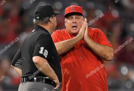 Mike Scioscia, Gerry Davis. Los Angeles Angels manager Mike Scioscia, right, argues with second base umpire Gerry Davis after Angels' Jefry Marte and Chicago White Sox's Tim Anderson were involved in a close play at first base during the eighth inning of a baseball game, in Anaheim, Calif