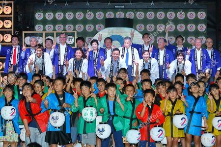 (Top row - L to R) Kunihiko Koyama, Keiichi Nagahashi, Daisuke Ozaki, Toshiei Mizuochi, Daichi Suzuki, Tooru Yamamoto, Akio Mimura, (second row - L to R) Tsunekazu Takeda, Eric M. Garcetti, Yuriko Koike, Yoshiro Mori, Fujio Mitarai, Shunichi Suzuki, (Bottom row - L to R) Kenji Fujimitsu, Miho Nonaka, Tadahiro Nomura, Rikako Ikee, Ryohei Kato