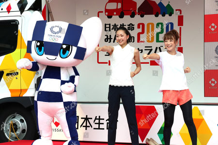 Japanese actress Nana Suzuki (R), former rythmic gymnast Airi Hatakeyama (C) and Tokyo 2020 Olympics mascot Miraitowa (L) learn karate exercise from karate champion Ryo Kiyuna at a kick-off ceremony for the Tokyo 2020 Olympics promotion caravan across Japan