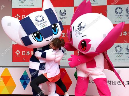 Stock Picture of Japanese actress Nana Suzuki (C) hugs with Tokyo 2020 Olympics mascot Miraitowa (L) and Tokyo 2020 Paralympics mascot Someity (R) at a kick-off ceremony for the Tokyo 2020 Olympics promotion caravan across Japan