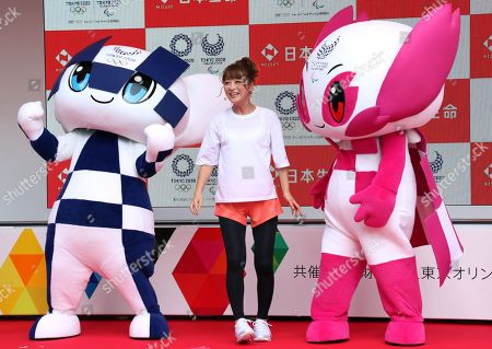 Japanese actress Nana Suzuki (C) smiles with Tokyo 2020 Olympics mascot Miraitowa (L) and Tokyo 2020 Paralympics mascot Someity (R) at a kick-off ceremony for the Tokyo 2020 Olympics promotion caravan across Japan