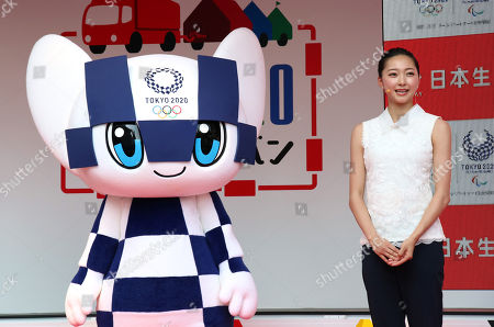 Stock Photo of Former rythmic gymnast Airi Hatakeyama (R) smiles with Tokyo 2020 Olympics mascot Miraitowa (L) at a kick-off ceremony for the Tokyo 2020 Olympics promotion caravan across Japan