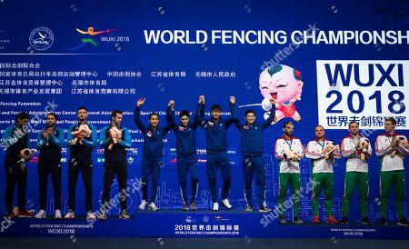(L-R) Enrico Berre, Luca Curatoli, Aldo Montano, Luigi Samale of Italy (Silver); Bongil Gu, Junghwan Kim, Junho Kim, Sanguk Oh  of Korea (gold); Tamas Decsi, Csanad Gemesi, Andras Szatmari, Aron Szilagyi of Hungary (bronze) celebrate on the podium of the team men's Saber at the Fencing World Championships in Wuxi, China, 25 July 2018.