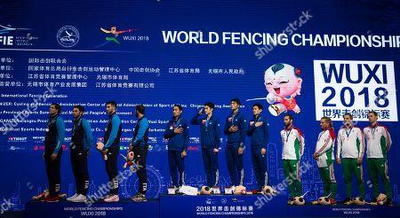 (L-R) Enrico Berre, Luca Curatoli, Aldo Montano, Luigi Samale of Italy (Silver); Bongil Gu, Junghwan Kim, Junho Kim, Sanguk Oh  of Korea (gold); Tamas Decsi, Csanad Gemesi, Andras Szatmari, Aron Szilagyi of Hungary (bronze) stand on the podium of the team men's Saber event at the Fencing World Championships in Wuxi, China, 25 July 2018.
