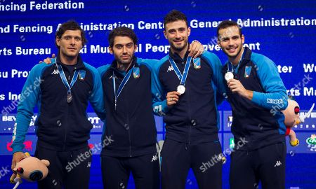 (L-R) Enrico Berre, Luca Curatoli, Aldo Montano, Luigi Samale of Italy celebrate with the silver medal on the podium after the team men's Saber at the Fencing World Championships in Wuxi, China, 25 July 2018.