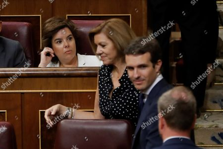 (L-R) Former Spanish deputy Primer Minister and People's Party (PP) member, Soraya Saenz de Santamaria, former Defence Minister and PP member, Maria Dolores de Cospedal, and Spanish People's party leader, Pablo Casado, during an extraordinary plenary session held at the Lower House of the Spanish Parliament, in Madrid, Spain, 25 July 2018. Congress is to vote the designation of Spanish journalist Rosa Maria Mateo as temporary head of Spanish public broadcaster RTVE.