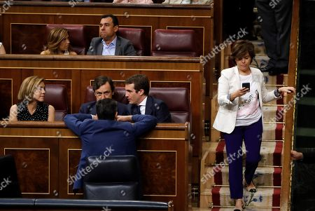 Spanish People's party (PP) leader, Pablo Casado (C), chats with the party's Parliamentary Spokesman, Rafael Hernando (2-L), and former Defence Minister and PP member Maria Dolores de Cospedal (L), as former Spanish deputy Prime Minister and People's Party member Soraya Saenz de Santamaria (R), passes by during an extraordinary plenary session held at the Lower House of the Spanish Parliament, in Madrid, Spain, 25 July 2018. Congress is to vote the designation of Spanish journalist Rosa Maria Mateo as temporary head of Spanish public broadcaster RTVE.
