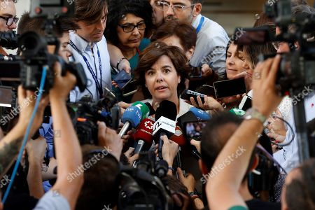 Spanish deputy Prime Minister and People's Party member Soraya Saenz de Santamaria (C) addresses the media at the end of an extraordinary plenary session held at the Lower House of the Spanish Parliament, in Madrid, Spain, 25 July 2018. Congress is to decide the designation of Spanish journalist Rosa Maria Mateo as temporary head of Spanish public broadcaster RTVE.