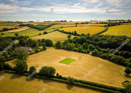 Stock Photo of Aerial view of Priston village Cricket Club, which has been watered and maintained during the ongoing hot weather that is covering the UK. Britain is on the brink of its hottest summer in 400 years with the savage hot weather engulfing the UK