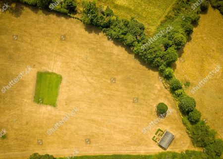 Stock Picture of Aerial view of Priston village Cricket Club, which has been watered and maintained during the ongoing hot weather that is covering the UK. Britain is on the brink of its hottest summer in 400 years with the savage hot weather engulfing the UK