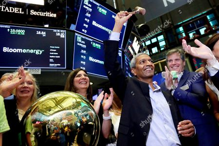 K.R. Sridhar, Colin Powell. Bloom Energy Founder, President and CEO K.R. Sridhar, is applauded as he raises the gavel after ringing a ceremonial bell on the New York Stock Exchange floor, when his company's IPO begins trading