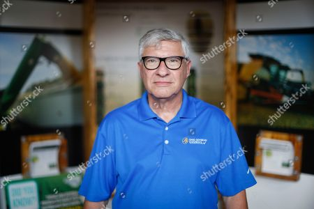 Tom Fontana, director of Research & Education for the Ohio Soybean Council, poses for a portrait after an interview at the Ohio State Fair, in Cincinnati. Ohio's Republican Gov. John Kasich on Wednesday helped open the Ohio State Fair by blasting President Donald Trump's tariff battles, which have left some farmers feeling less than festive