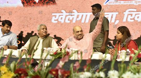BJP President Amit Shah with Youth wing President Poonam Mahajan and party leader Ram Lal during the Khelo Bharat Programme organized by BJP Yuva Morcha at Talkatora Stadium on July 25, 2018 in New Delhi, India.