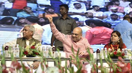 BJP President Amit Shah gestures as Youth wing President Poonam Mahajan and party leader Ram Lal look on, during the Khelo Bharat Programme organized by BJP Yuva Morcha at Talkatora Stadium on July 25, 2018 in New Delhi, India.