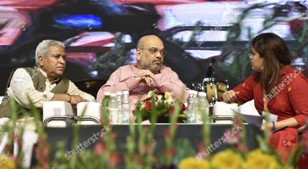 BJP President Amit Shah speaks with Youth wing President Poonam Mahajan as party leader Ram Lal looks on, during the Khelo Bharat Programme organized by BJP Yuva Morcha at Talkatora Stadium on July 25, 2018 in New Delhi, India.