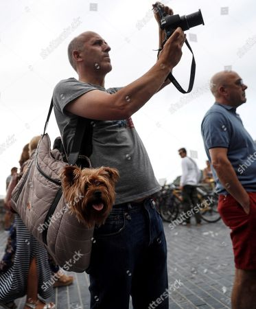 A man takes a picture of Panamanian singer Ruben Blades (unseen) as he performs on stage during the opening day of the 53rd edition of the Jazzaldia Festival in San Sebastian, Basque Country, northern Spain, 25 July 2018. The Jazzaldia festival runs from 25 July until 29 July 2018.